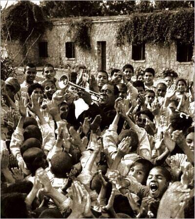 Louis Armstrong entertaining hospitalised children at the Tahhseen Al-Sahha Medical Centre, Cairo (1961).